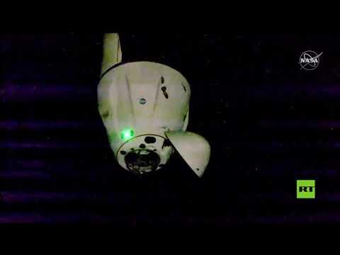 شاهد المركبة دراغون تلتحم بالمحطة الفضائية الدولية