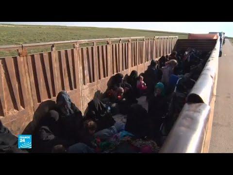 شاحنات تقل مقاتلين وعائلاتهم من آخر معقل لهم في سورية