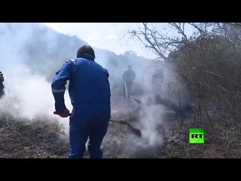 شاهد رئيس بوليفيا يشارك شخصيًا في إخاد حرائق الأمازون
